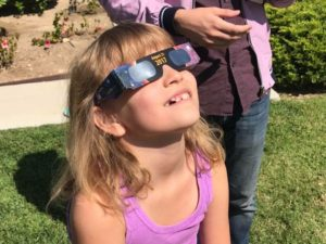 Girl in 2017 Solar Eclipse glasses